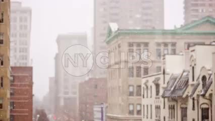 buildings in winter - snowing in Manhattan - New York City