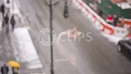snow on street in winter - overhead view of Manhattan road with cars and taxi cabs in NYC