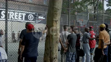 man takes jumpshot at famous West 4th Street basketball courts in slow motion 4K Manhattan NYC