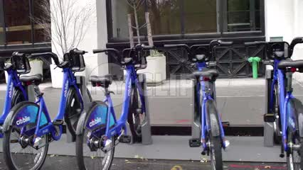 CitiBikes in row - blue bicycles parked at docking station in NYC