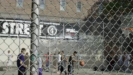 kid scores layup in practice at West 4th Street basketball courts on 6th Ave - slow motion 4K in Manhattan NYC