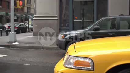 hood of taxicab driving - cab moving past construction site with fiber optic cables in slow motion in Manhattan street in NYC