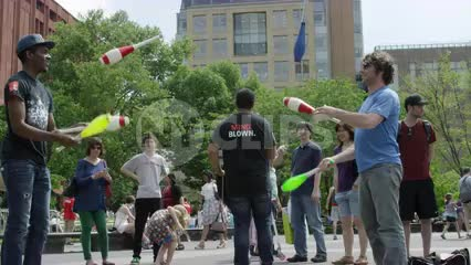 jugglers in Washington Square Park on summer day - juggling pins in NYC