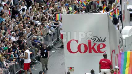 Gay Pride March in Manhattan - huge crowd of people waving rainbow flags in support of LGBT in 4K and 1080 HD in NYC
