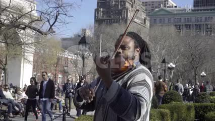 man playing violin in Washington Square Park on fall day in NYC - no audio