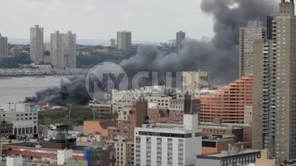building on fire with smoke on west side of Manhattan in NYC