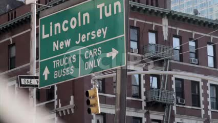 Lincoln Tunnel sign to New Jersey - trucks buses, cars only arrows - close-up in NYC