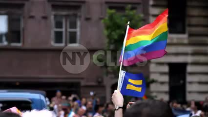 gay pride flag waving and LGBT float in parade in NYC
