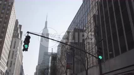 driving through green light with view of Empire State Building from 34th Street in NYC