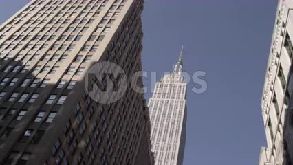 Empire State Building upward view from moving car in Manhattan NYC in 4K and 1080 HD