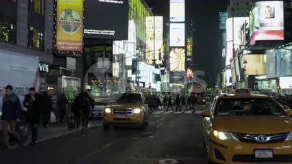 Times Square taxicab driving in slow motion at night in NYC