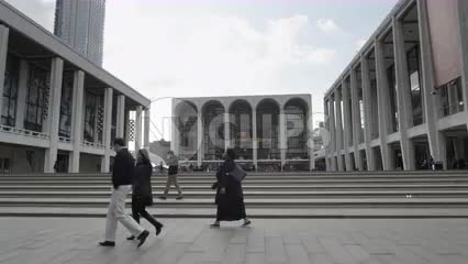 driving past Lincoln Center main entrance front steps on fall day in Manhattan New York City