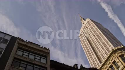 Empire State Building from moving car street view upward angle on beautiful day in 4K and 1080 HD NYC