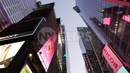 upward angle in Times Square in early evening - driving through billboards and ads in New York City