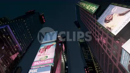 driving through Times Square with upward angle from moving car at night in New York City