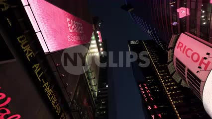 upward view of Times Square billboards and lights at night in NYC in 4K and 1080 HD