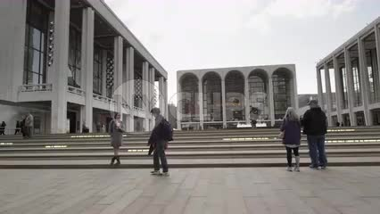 driving past Lincoln Center on fall day - front steps entrance in NYC
