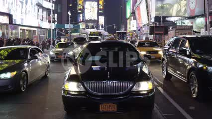 Uber car driving through Times Square at night in New York City