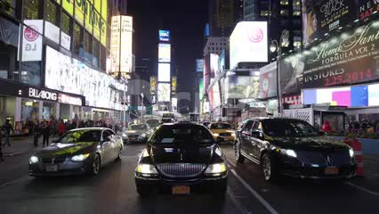 Uber driving in Times Square in slow motion at night - limousine grill in NYC