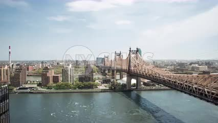 pushing in on Queensboro Bridge over East River in timelapse NYC
