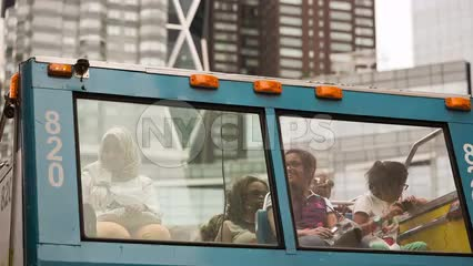 happy tourists on City Sights tour bus at Columbus Circle on summer day in NYC