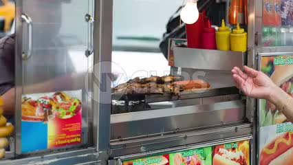 street food - hand taking change - cash exchange - woman at shish kabob food cart on summer day in NYC