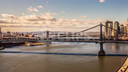 Brooklyn and Manhattan Bridge panning to downtown skyline - day to night timelapse in 4K and 1080 HD NYC
