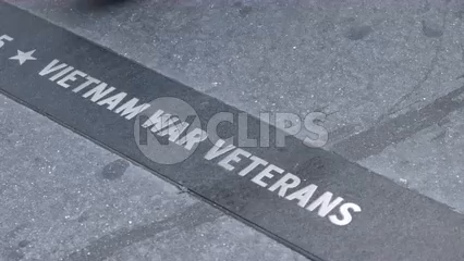 disrespectful people stepping on Vietnam War Veterans plaque on sidewalk - shoes - feet walking past and ignoring heroes - slow motion 4K NYC