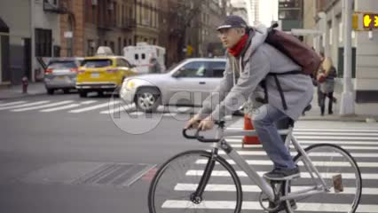 man on bicycle riding in Chelsea on fall day in Manhattan NYC