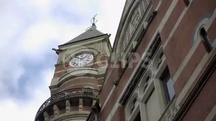 Jefferson Market Library clock tower, upward angle in Greenwich Village on beautiful day tilting down to street, Manhattan NYC