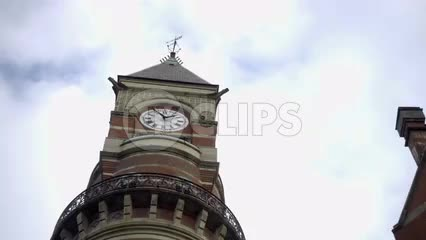 clock tower on Jefferson Market Library close up zooming out to street in Greenwich Village in NYC