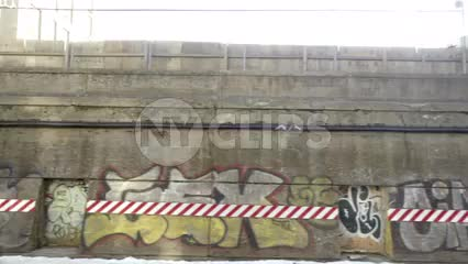 gritty graffiti art on subway wall outside - view from moving train in 1080 HD NYC