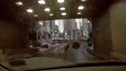 emerging from the Brooklyn Battery Tunnel into Manhattan with Freedom Tower overhead in New York City