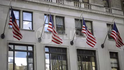 4 American flags waving on building in Midtown Manhattan in NYC