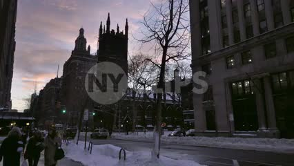 women walking down street on winter evening at sunset - First Presbyterian Church - snow on ground on 5th Avenue