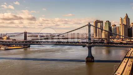 Manhattan Bridge and Brooklyn Bridge from day to night time-lapse - zooming out slowly in 4K and 1080 HD NYC