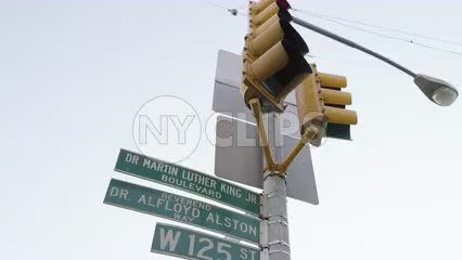 Dr. Martin Luther King Jr Boulevard and Reverend Dr. Alfloyd Alston Way sign on West 125th Street in Harlem