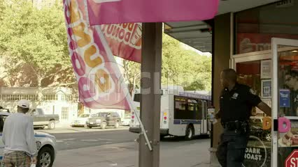 police officers - partners coming out of Dunkin Donuts in Harlem New York City - NYPD cops at donut shop