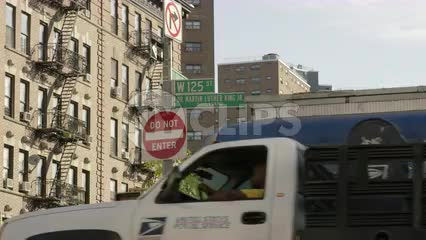 125th Street and Martin Luther King Jr, BLVD and do not enter sign in Harlem cars driving by 4K NYC
