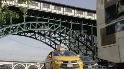 elevated 1, 2 and 3 subway train at 125th street in Harlem with cars below driving on street 4K