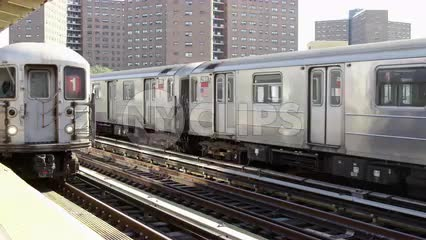 1 train arriving as another subway train leaving on elevated track in 125th street Harlem station platform