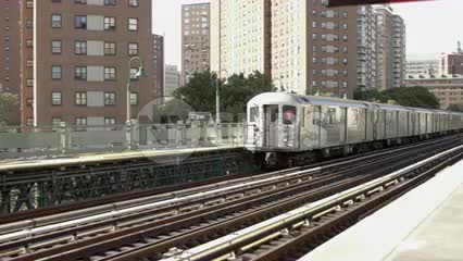 1 Train entering elevated 125th street station in Harlem NYC