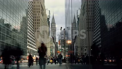 Chrysler Building on busy crowded Midtown Manhattan street - 4K timelapse of 42nd st from day to night