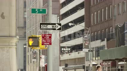 5th Ave sign with cars driving - one way sign and don't walk light