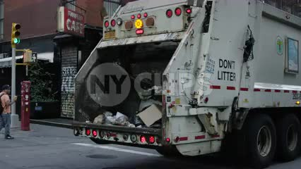 garbage truck driving in SoHo in slow motion in NYC