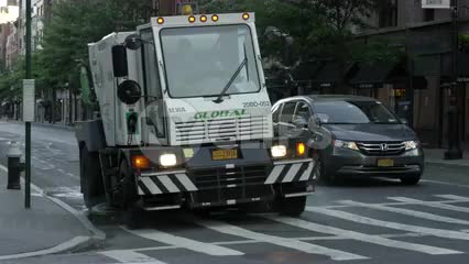 street sweeper cleaning street early in morning in Manhattan
