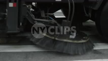 street sweeper driving close up slow motion brushes spinning Manhattan NYC