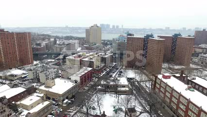 Lower East Side housing projects aerial pulling back over red brick buildings 4K NYC