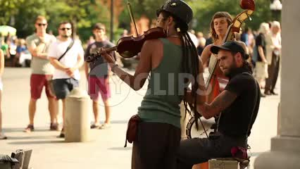 musicians playing violin and cello on summer day in Washington Square Park in NYC
