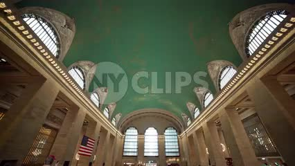 busy Grand Central Station interior main big room - tilting down from ceiling to stairs in summer NYC